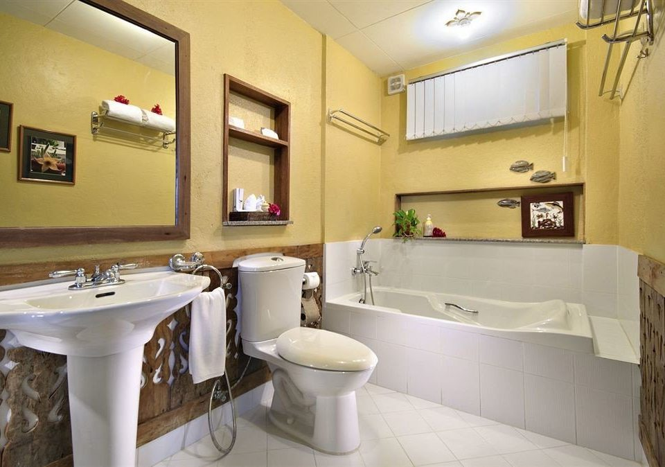 bathroom mirror sink property home cottage Suite Kitchen tub bathtub Bath tan tiled