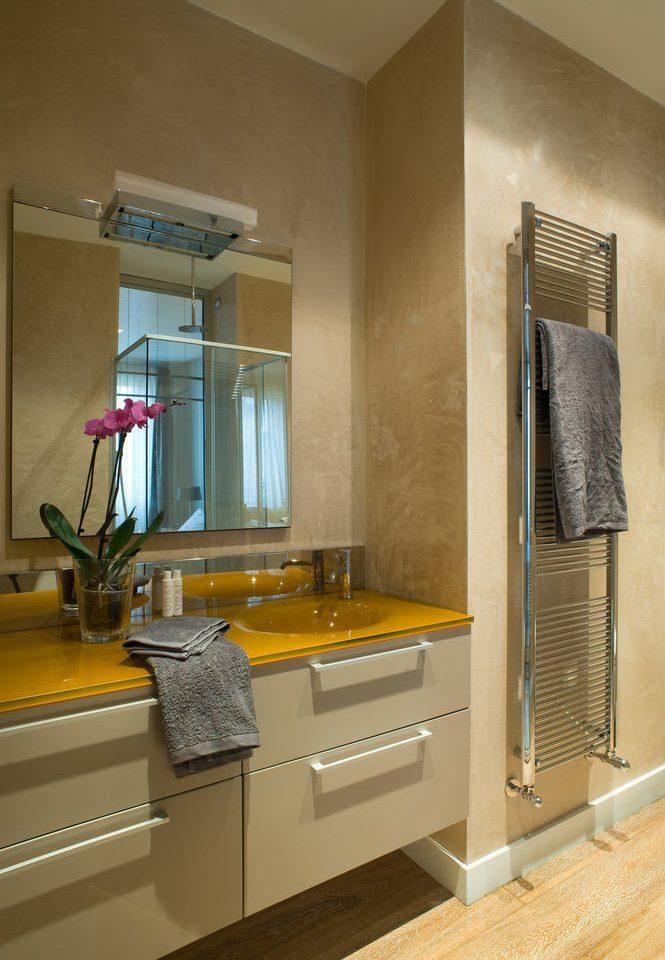 bathroom property cabinetry sink hardwood countertop home flooring Kitchen living room Suite tile Bath
