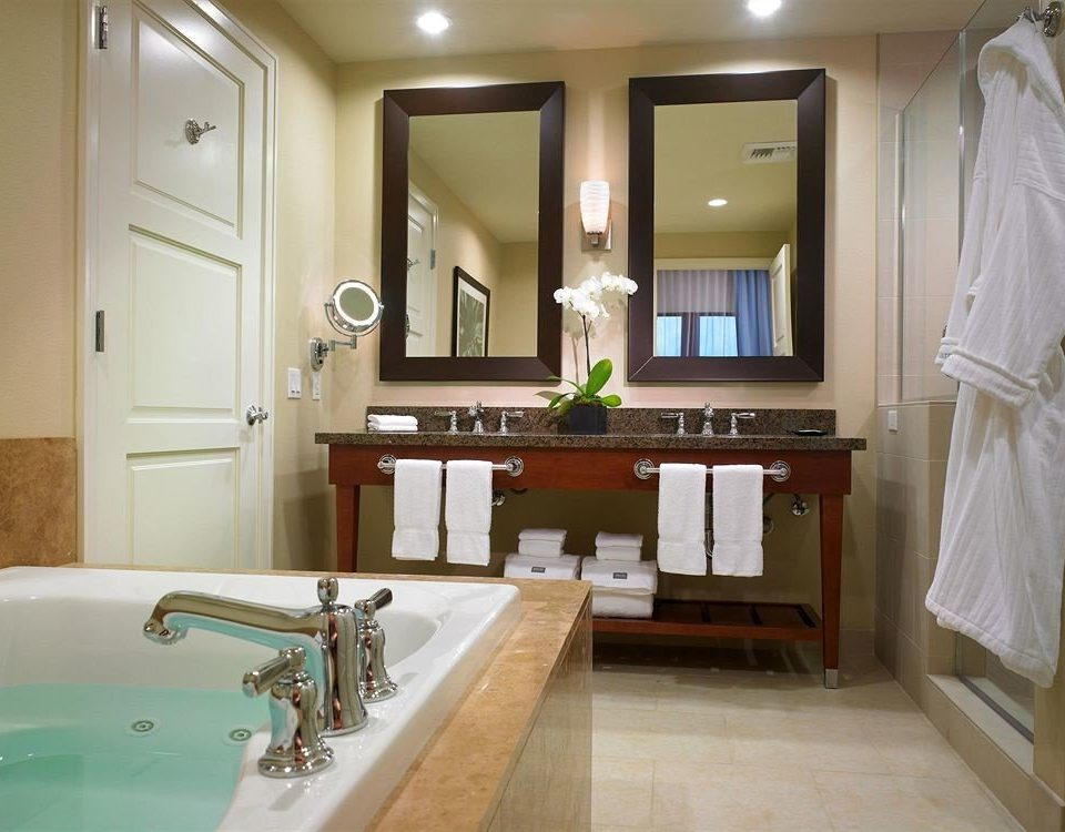 bathroom sink mirror property home cabinetry countertop Kitchen Suite cottage flooring mansion tub Bath bathtub tan