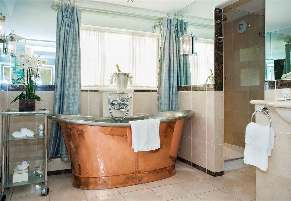 bathroom property tub cabinetry home Kitchen bathtub Bath Suite cottage tile tiled