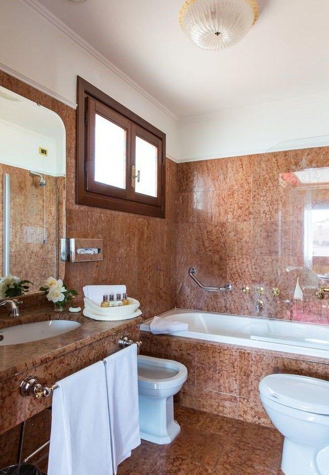 bathroom sink property home hardwood cottage farmhouse countertop Kitchen Suite toilet tub Bath bathtub tan