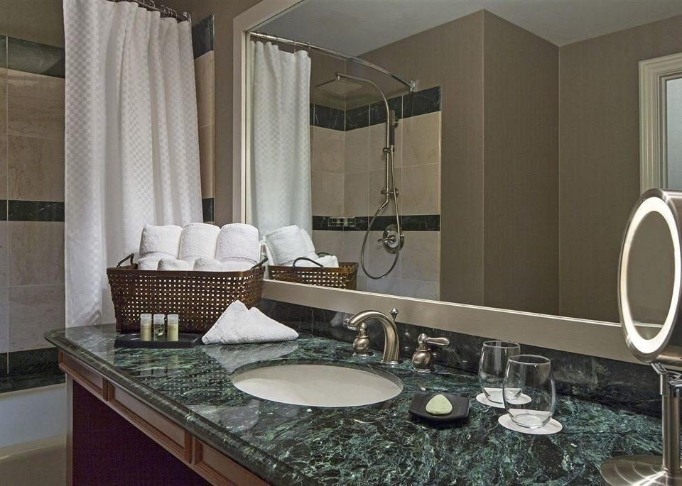 bathroom sink property countertop counter towel home Suite condominium Kitchen material tub Bath rack bathtub