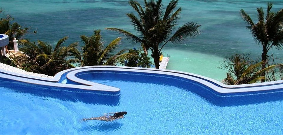 tree water Pool swimming pool reef leisure Resort plant Water park palm caribbean Lagoon swimming Sea blue shore Bath