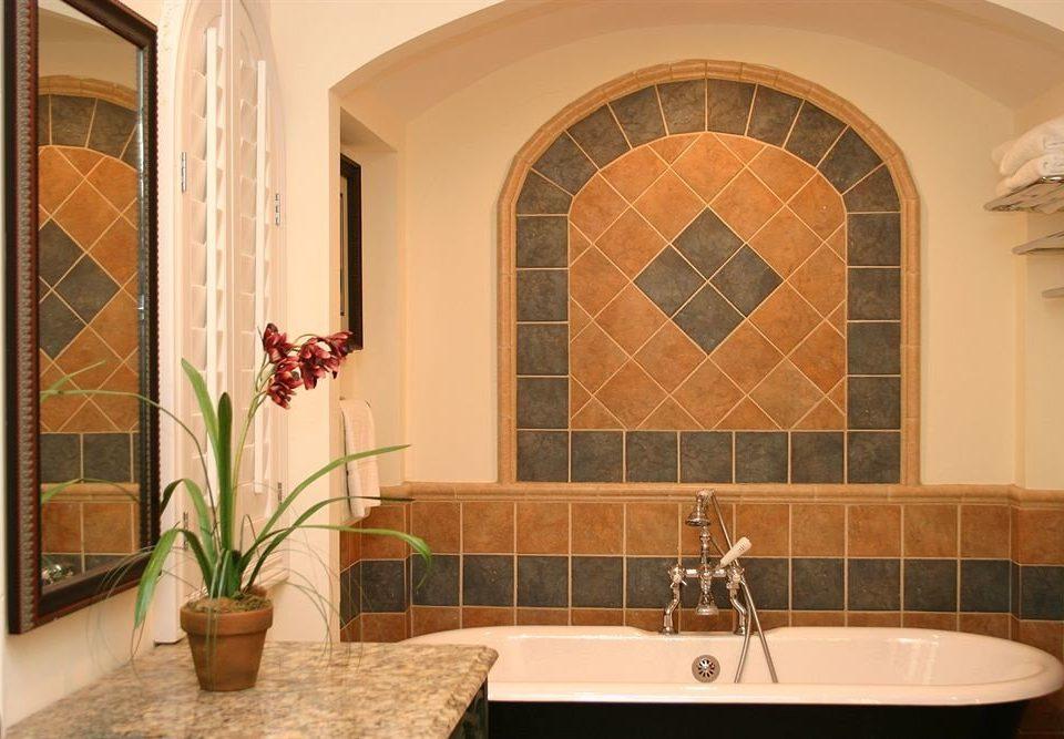 bathroom property home sink Lobby flooring mansion tile tub Bath tiled bathtub