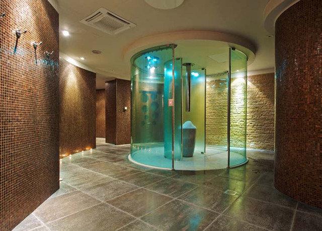 bathroom property swimming pool Lobby building green shower flooring tub tiled Bath tile