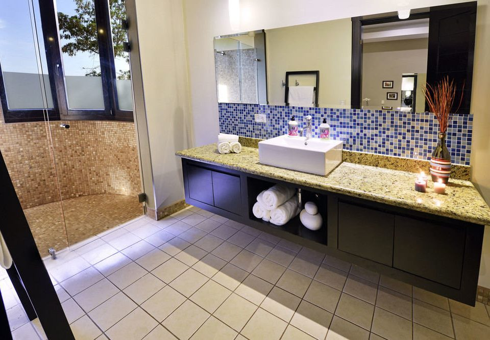 bathroom property sink home counter flooring Suite condominium Lobby tile tiled Bath