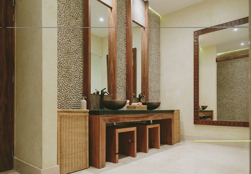 bathroom mirror property sink Lobby flooring hall cabinetry Suite tile tiled Bath