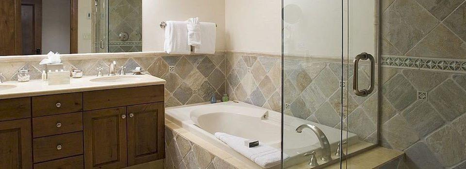 Bath Lodge bathroom vessel property sink plumbing fixture home flooring tile cottage tub tan bathtub