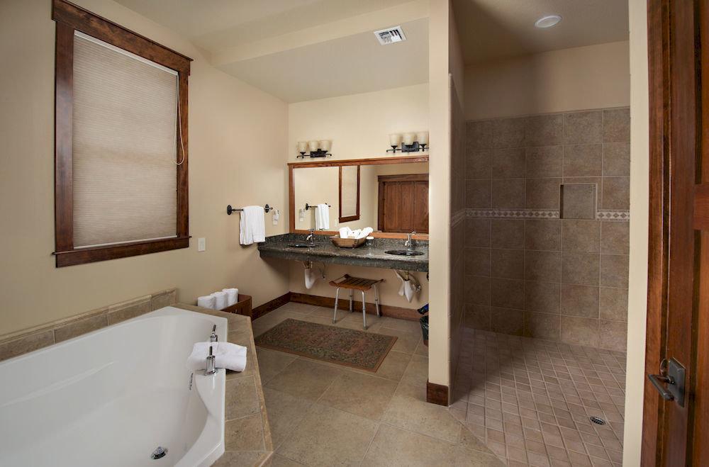 Bath Lodge Rustic bathroom mirror sink property home Suite cottage tile tub tiled bathtub tan