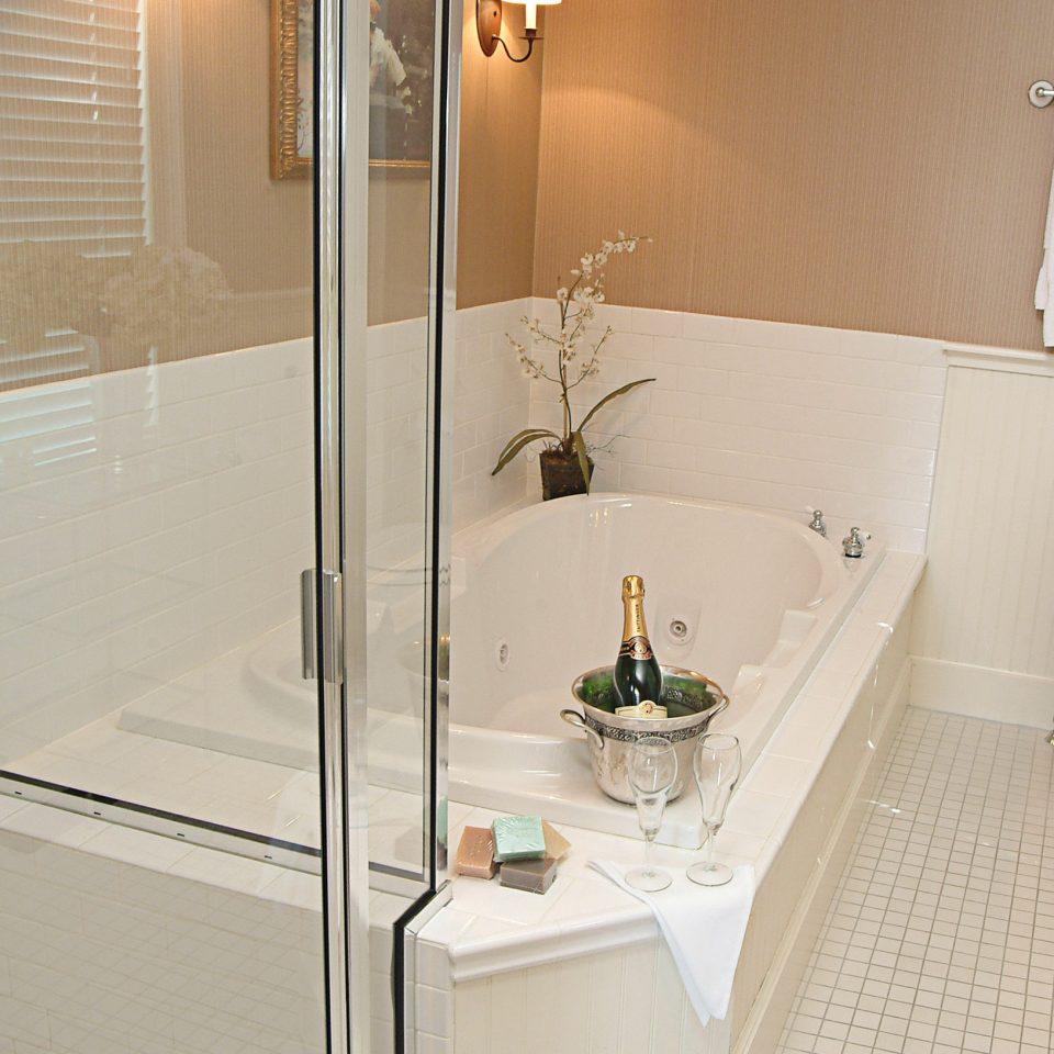 Bath Luxury bathroom property bathtub plumbing fixture flooring tile