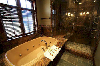 Bath Luxury bathroom man made object property swimming pool sink tub vessel bathtub cottage jacuzzi tile tiled
