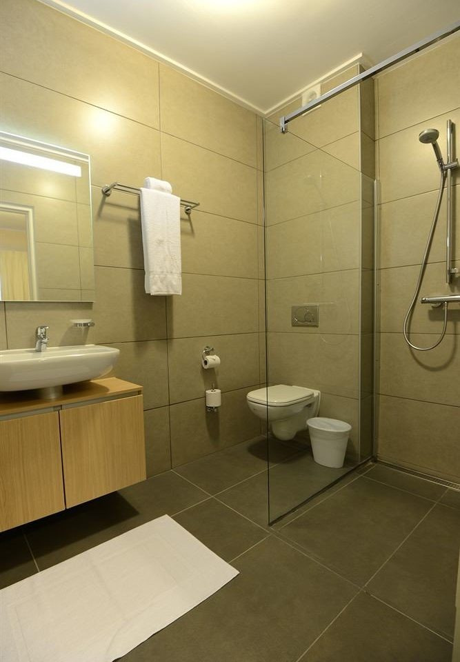 Bath Luxury bathroom property sink plumbing fixture home public toilet flooring tile