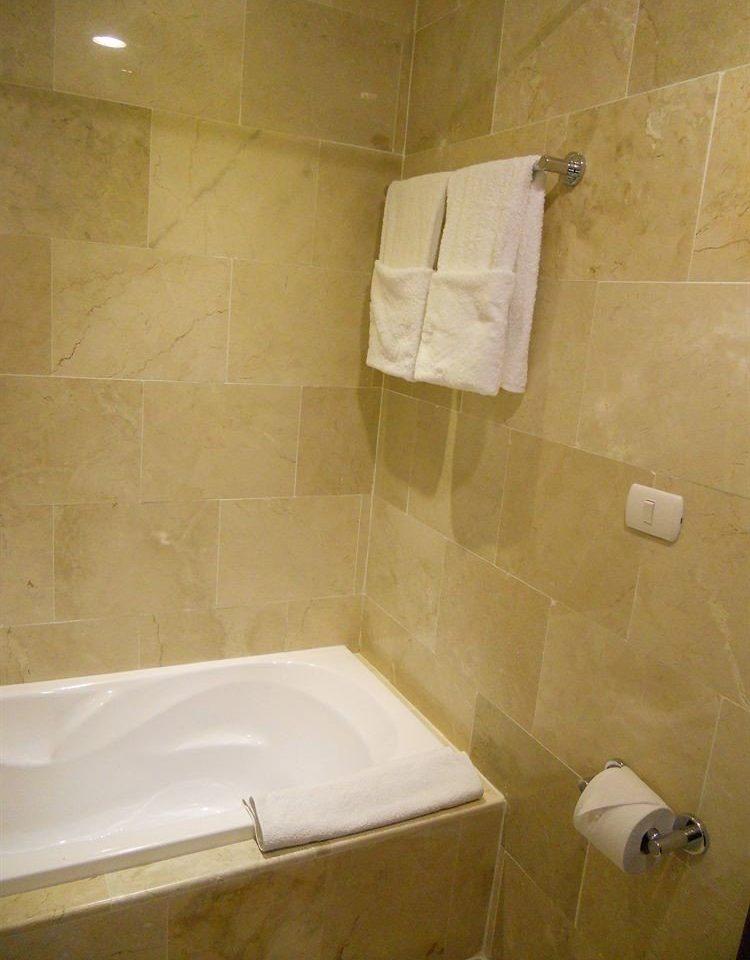Bath Luxury Modern bathroom property vessel bathtub plumbing fixture tile flooring bidet toilet public toilet tan tiled