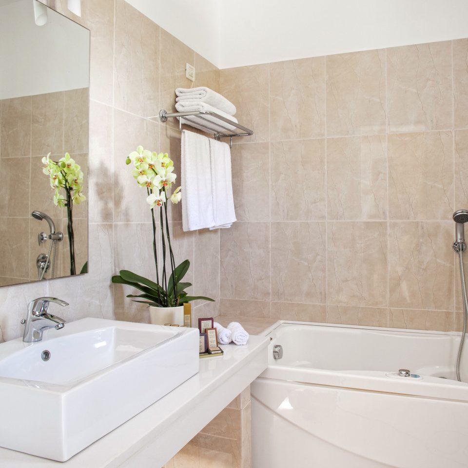 Bath Luxury Modern bathroom vessel property sink bathtub plumbing fixture tub bidet flooring tile water basin tiled