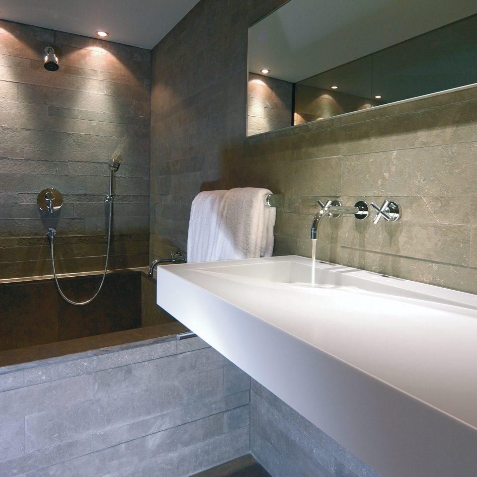 Bath Luxury Modern bathroom sink mirror property swimming pool bathtub plumbing fixture vessel daylighting flooring tile double tub tiled