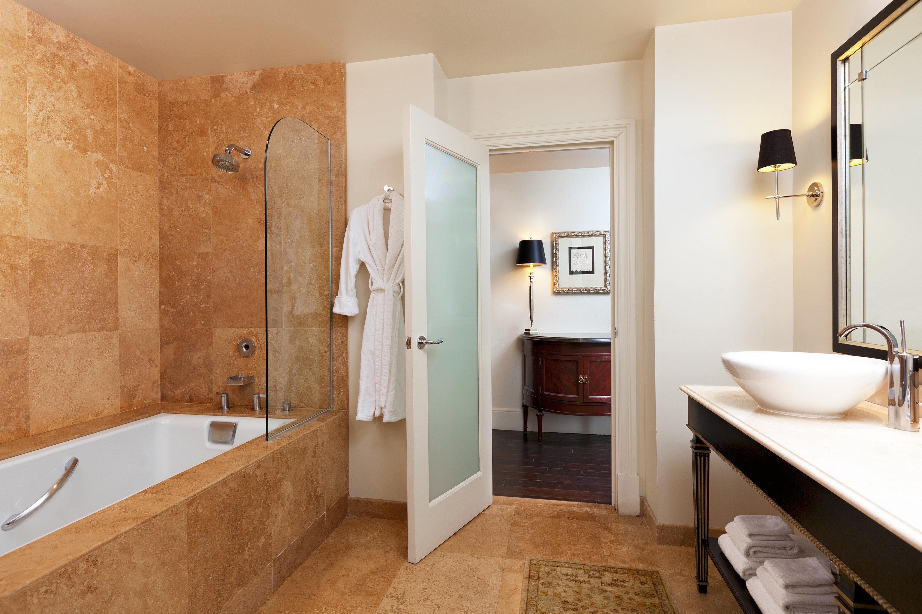 Bath Luxury bathroom property sink Suite home flooring plumbing fixture cottage tan Modern tub bathtub