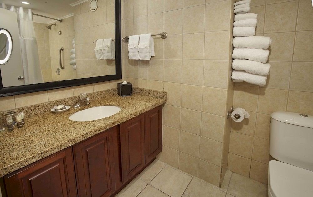 Bath Luxury Resort Romantic bathroom sink property toilet cottage flooring plumbing fixture tile tan