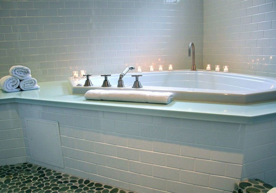 Bath Luxury Romantic bathroom swimming pool bathtub vessel sink plumbing fixture jacuzzi bidet tile toilet tiled water basin