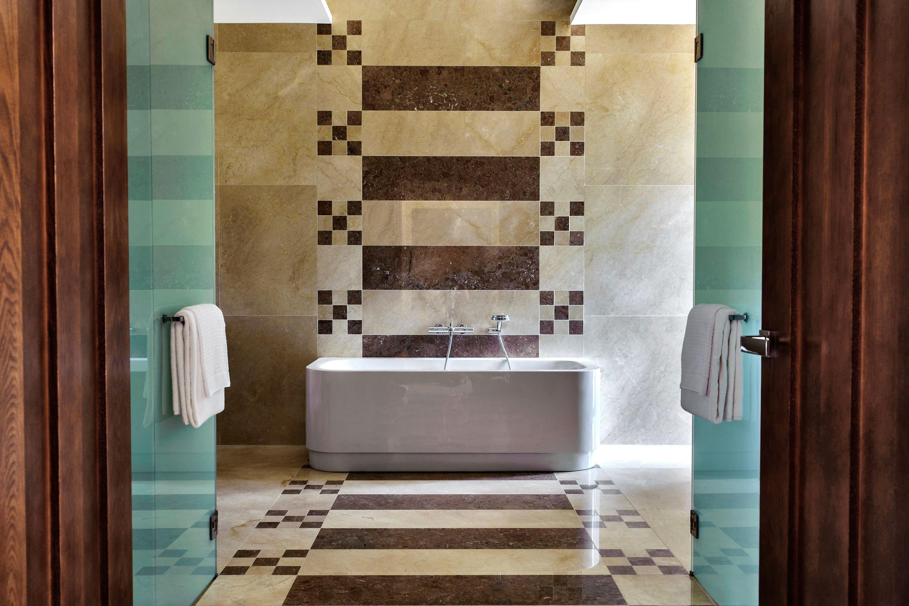 Bath Luxury Romantic Rustic bathroom tile flooring plumbing fixture home tub tiled bathtub