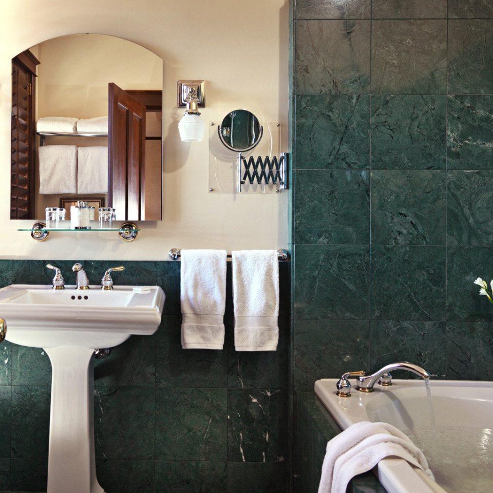 Bath Luxury Rustic bathroom sink property tub home toilet plumbing fixture bathtub Suite tiled