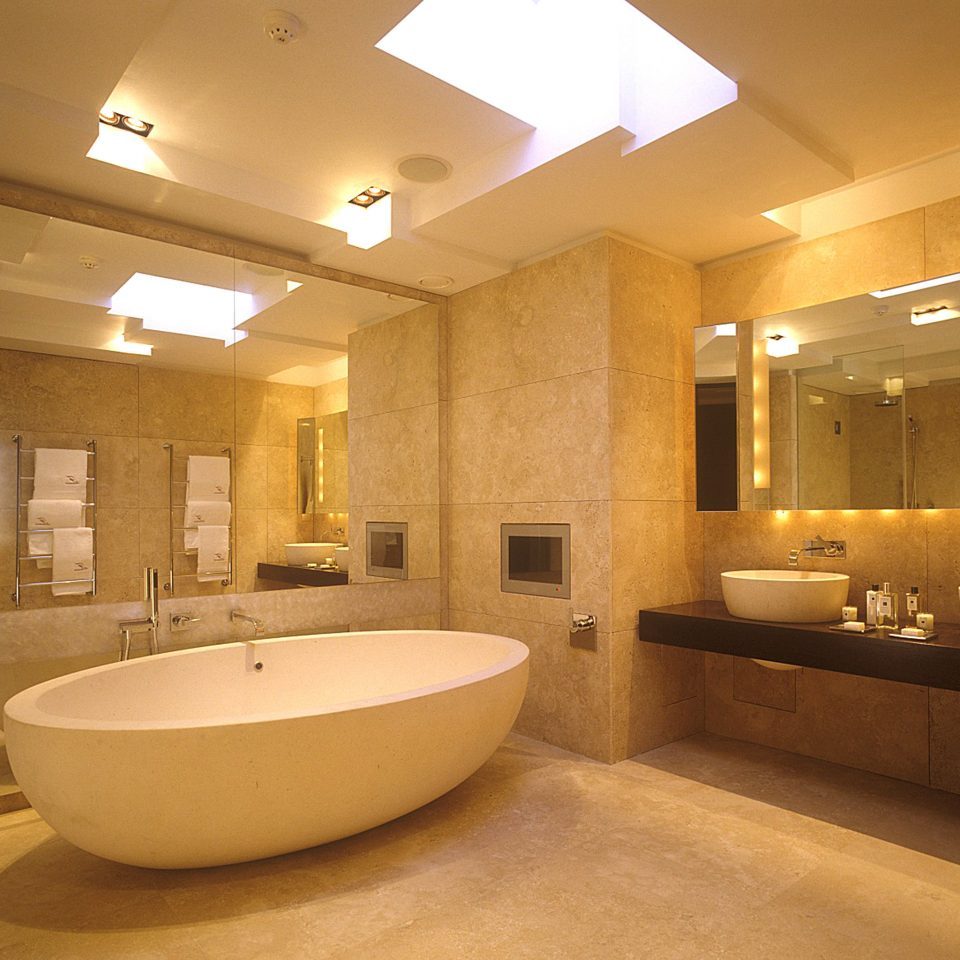 Bath Luxury bathroom property sink swimming pool bathtub lighting Suite plumbing fixture flooring tub