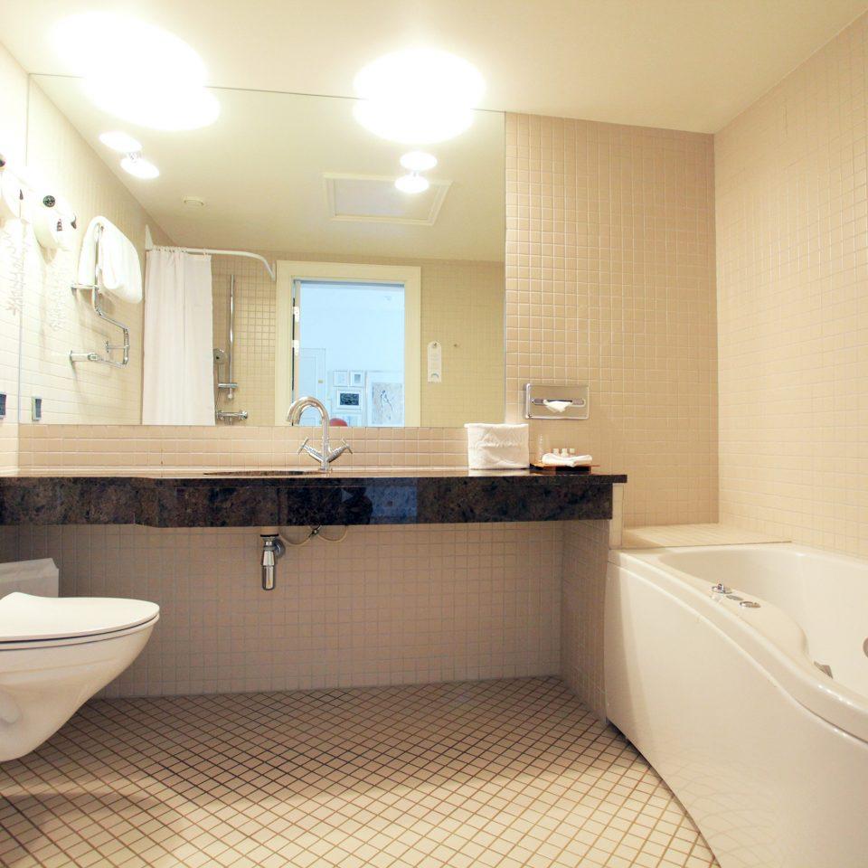 Bath Luxury bathroom property sink tub home Suite bathtub cottage toilet tile tiled