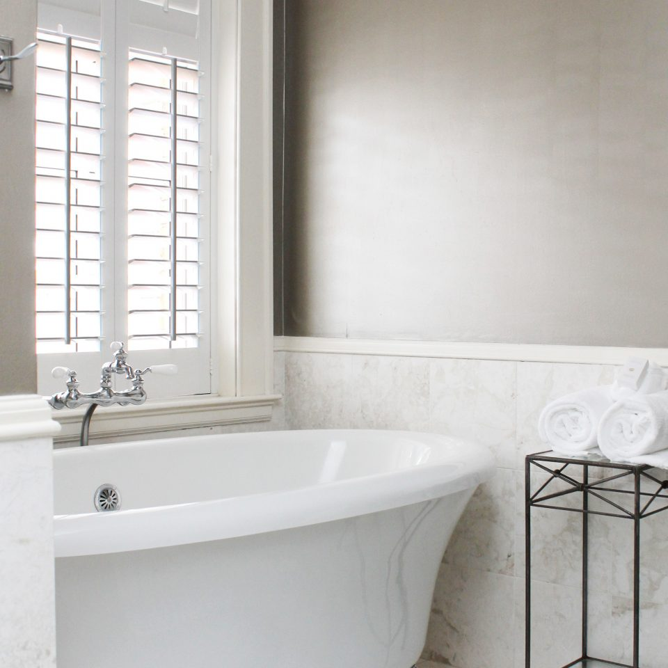 Bath Modern bathroom bathtub plumbing fixture tub bidet sink tile flooring bathroom cabinet toilet tiled