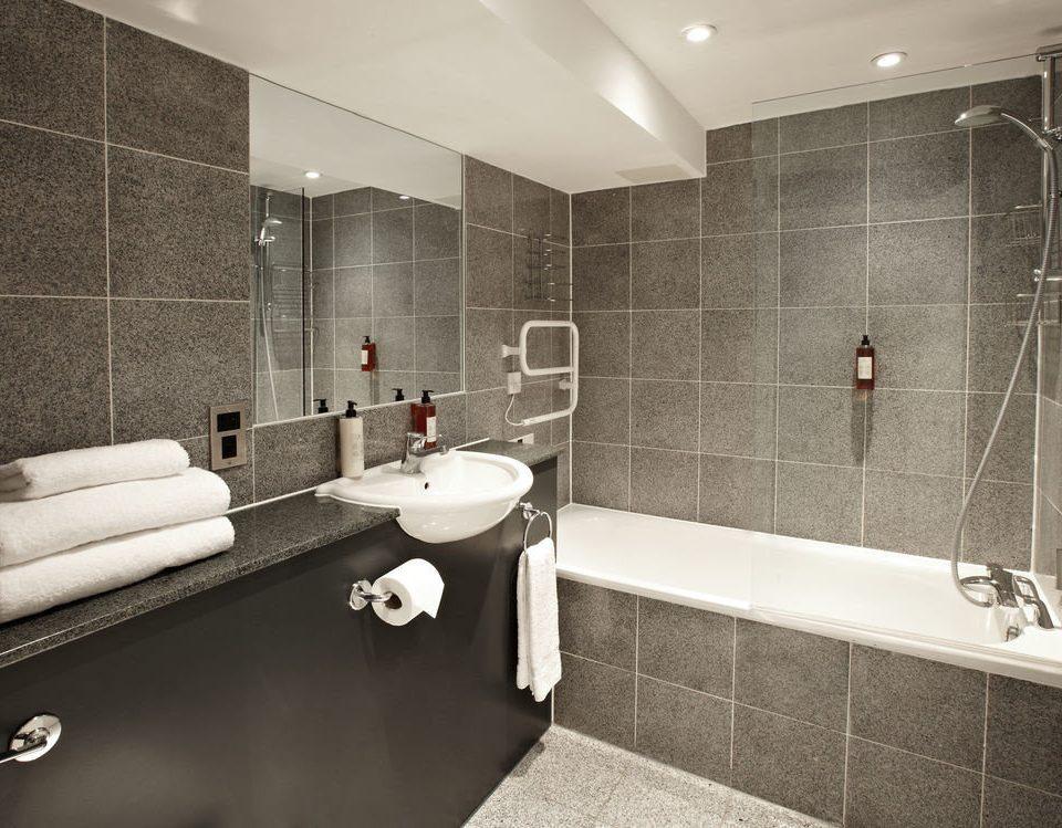 bathroom sink mirror property bathtub plumbing fixture toilet flooring home counter tile tiled Modern tub Bath