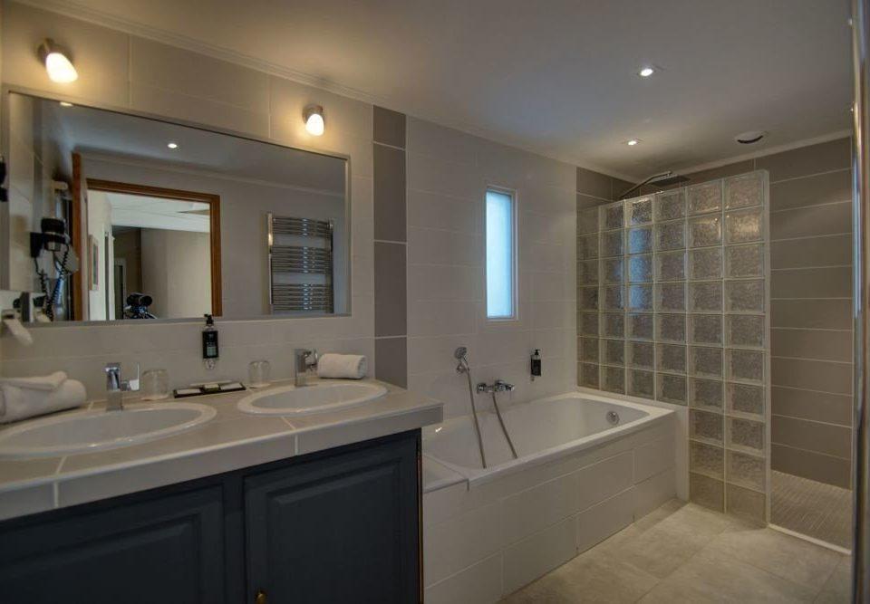 bathroom sink mirror property home flooring tile Modern tub clean bathtub Bath