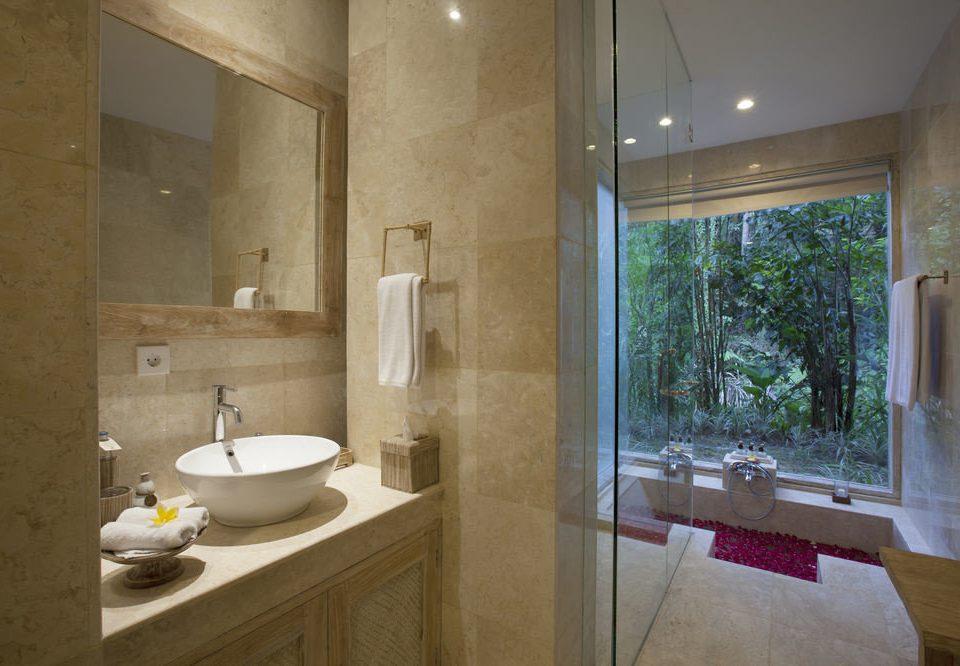 bathroom property sink home flooring tub plumbing fixture Bath Modern tile tiled bathtub stone