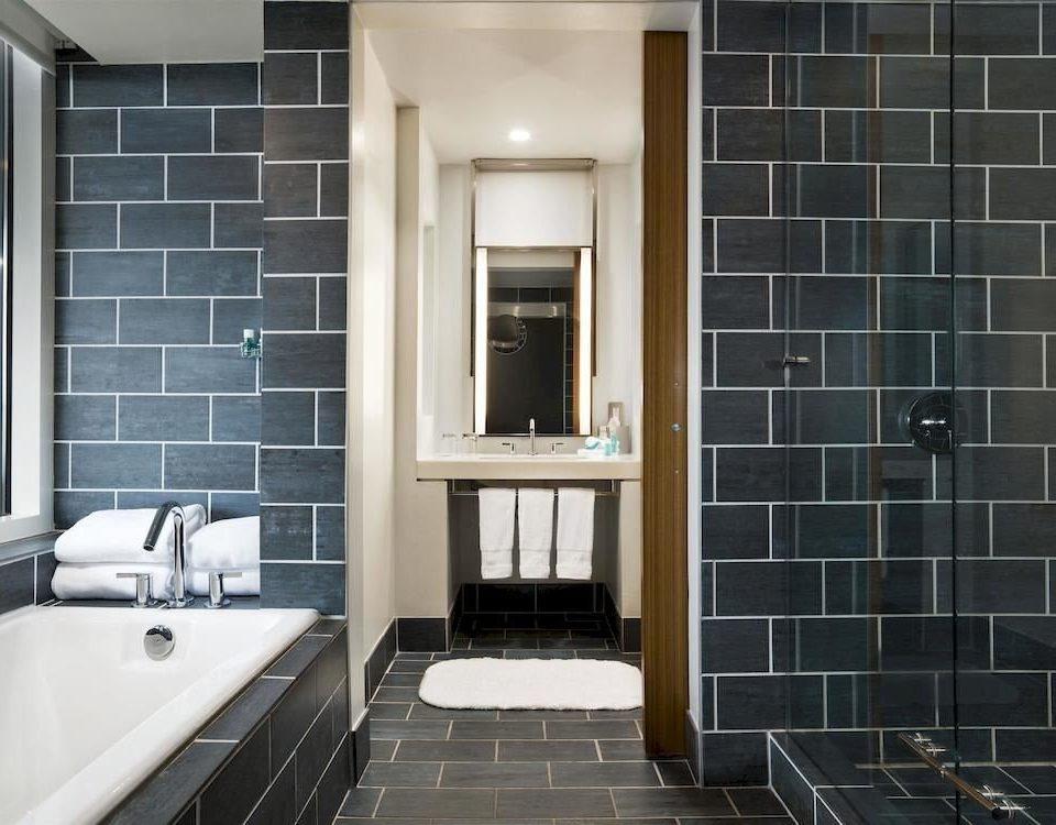 bathroom property sink black home tiled flooring tile daylighting living room tub toilet Modern bathtub Bath square