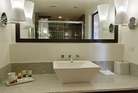 bathroom sink mirror property toilet countertop Modern tub Bath bathtub
