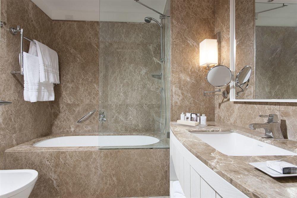 bathroom sink mirror property countertop towel counter home toilet tile flooring plumbing fixture vanity material Modern cottage tub bathtub tan Bath tiled
