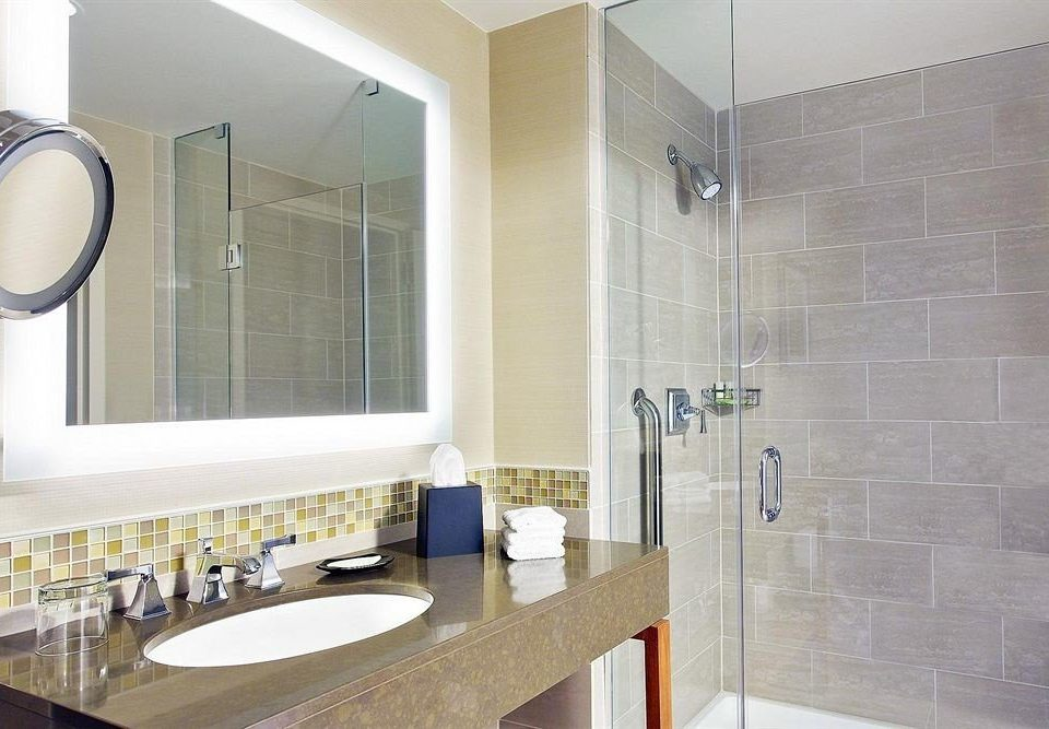 bathroom sink property mirror flooring tile plumbing fixture tiled Modern tub clean Bath bathtub