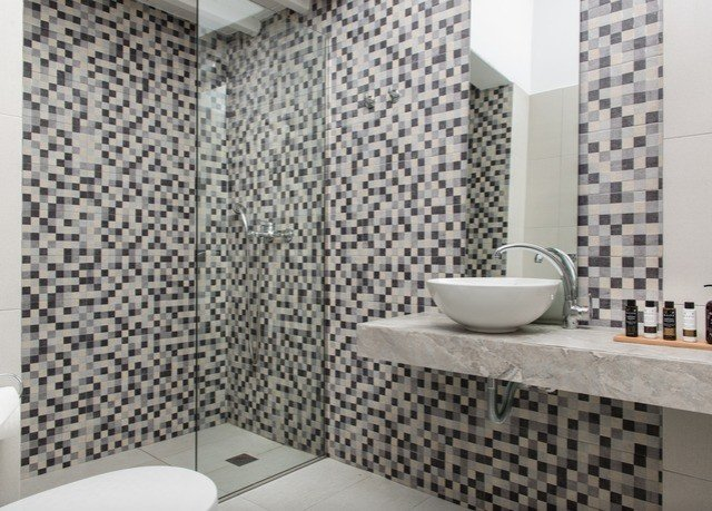 bathroom tiled sink tile flooring shower toilet plumbing fixture ceramic bidet pattern tub bathtub Bath Modern