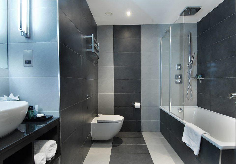 bathroom sink mirror toilet plumbing fixture public toilet shower bidet Modern tile tiled tub bathtub Bath