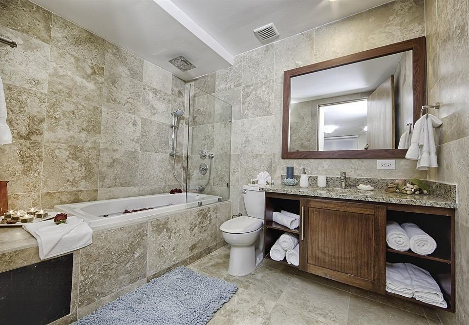 bathroom property sink home stone tub cottage flooring Bath bathtub Modern tile tan
