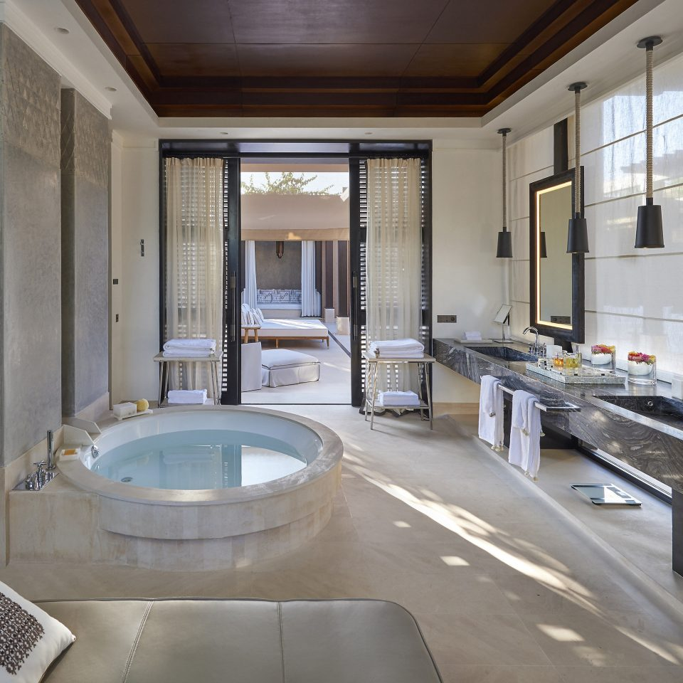 bathroom property home tub house mansion flooring swimming pool condominium bathtub tile plumbing fixture Bath Modern tiled stone