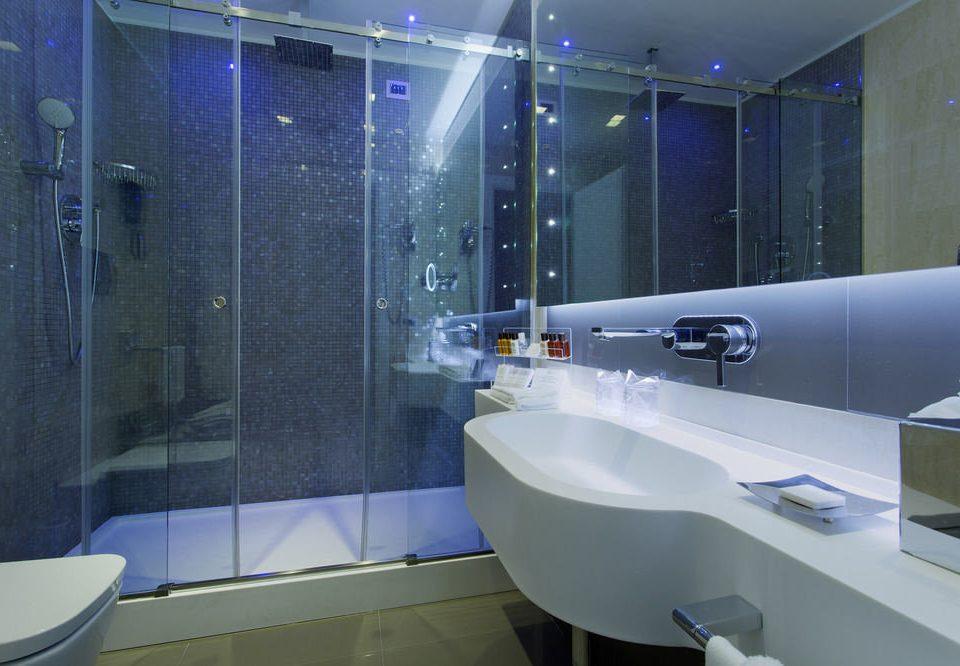 bathroom swimming pool bathtub plumbing fixture sink public toilet Modern tub tiled Bath