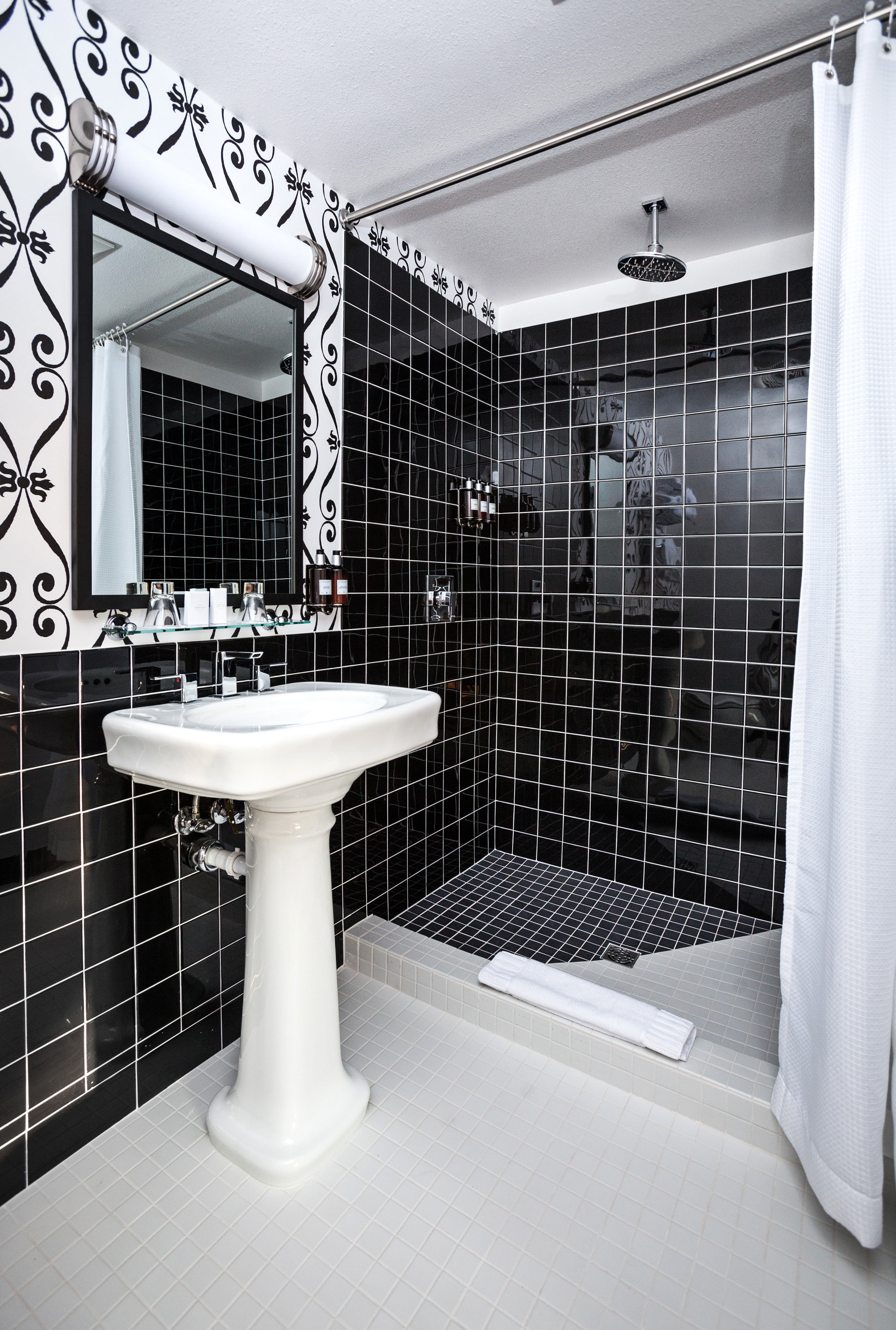 Bath Modern bathroom white plumbing fixture black tile tiled bathtub flooring bidet toilet tub