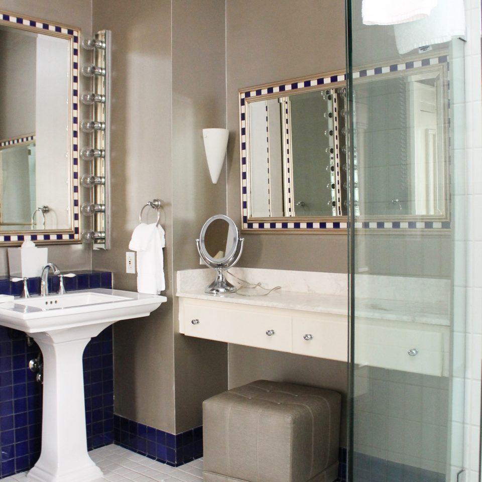 Bath Modern bathroom property sink cabinetry plumbing fixture toilet rack tiled