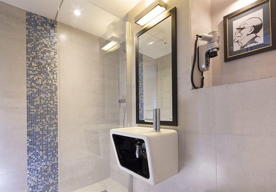 bathroom mirror sink toilet plumbing fixture white flooring tiled Modern tile Bath