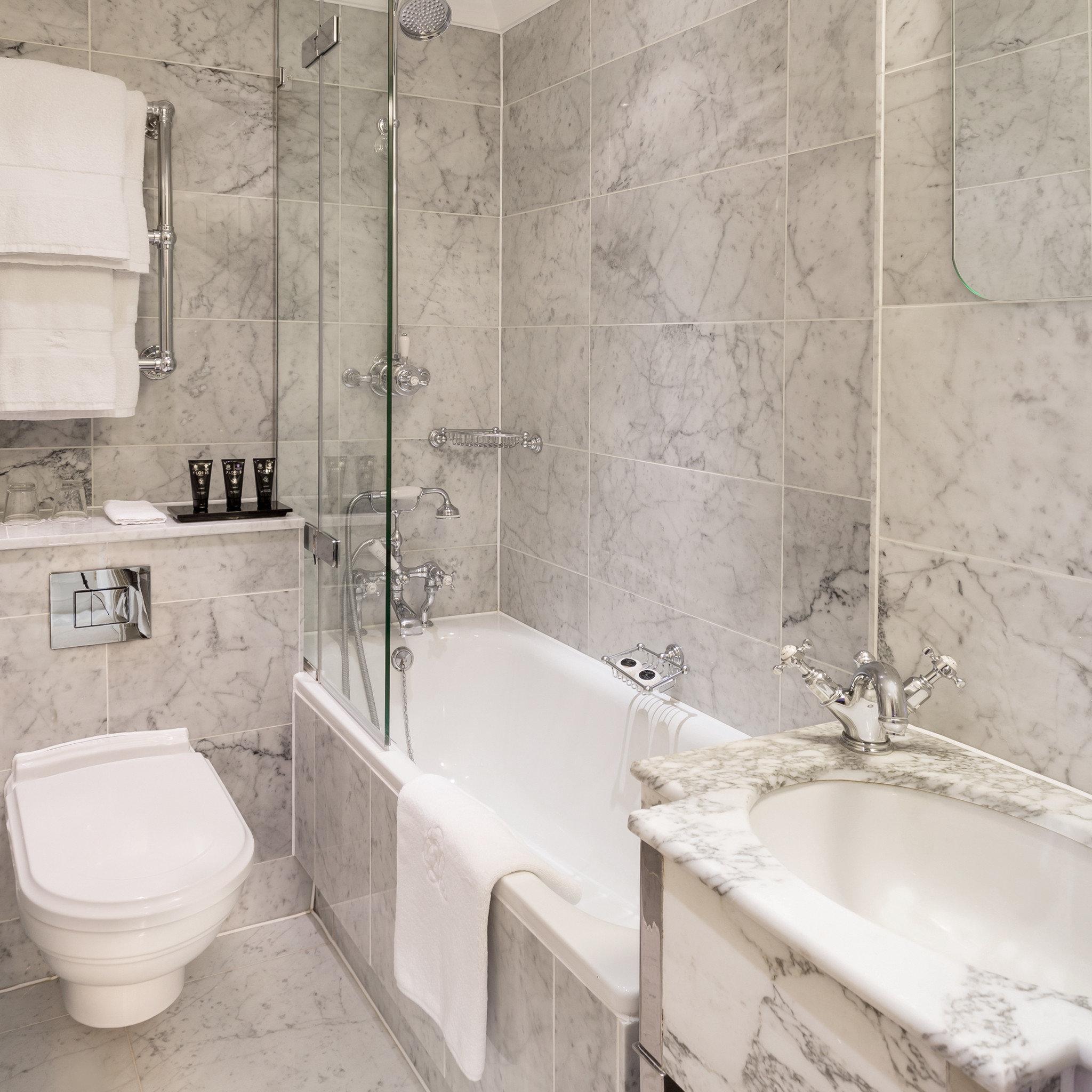 Bath Modern Resort bathroom white plumbing fixture tile bathtub bidet toilet flooring vessel tub tiled tan