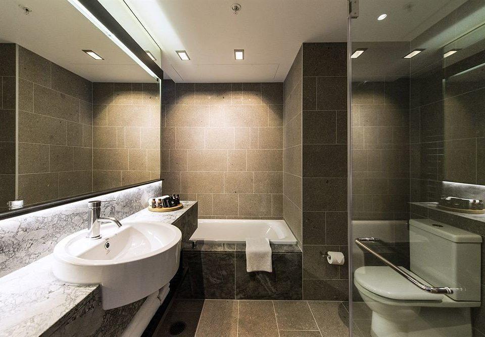 bathroom toilet property sink Suite plumbing fixture public toilet tub tiled public Bath Modern bathtub tile