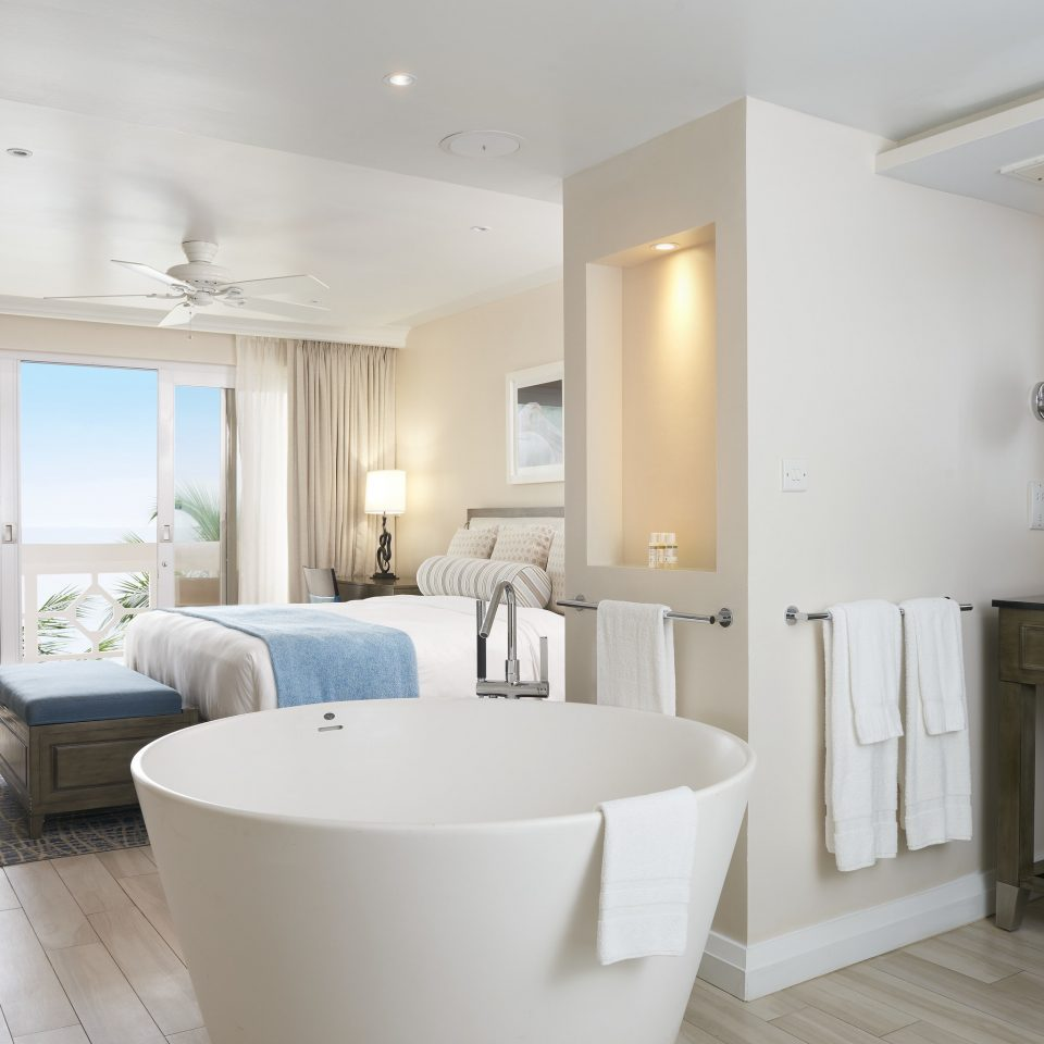 property bathroom home sink interior designer Suite plumbing fixture living room flooring tub Modern bathtub Bath