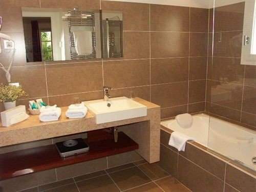 bathroom sink property mirror plumbing fixture home Suite flooring tile tiled Modern tub Bath