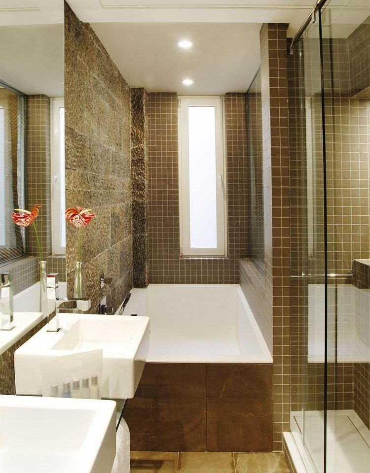 bathroom property toilet flooring sink Suite tile plumbing fixture bathtub tiled tub Modern Bath
