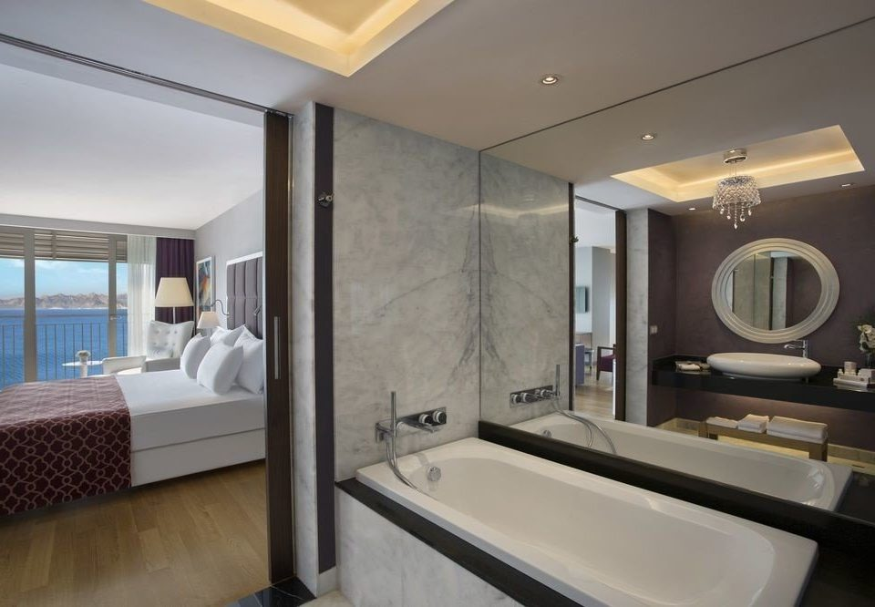 bathroom mirror sink property home condominium Suite living room tub Bath Modern clean bathtub
