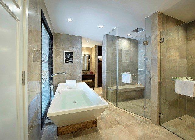 bathroom property mirror sink Suite plumbing fixture bathtub public toilet toilet Modern Bath tub tan