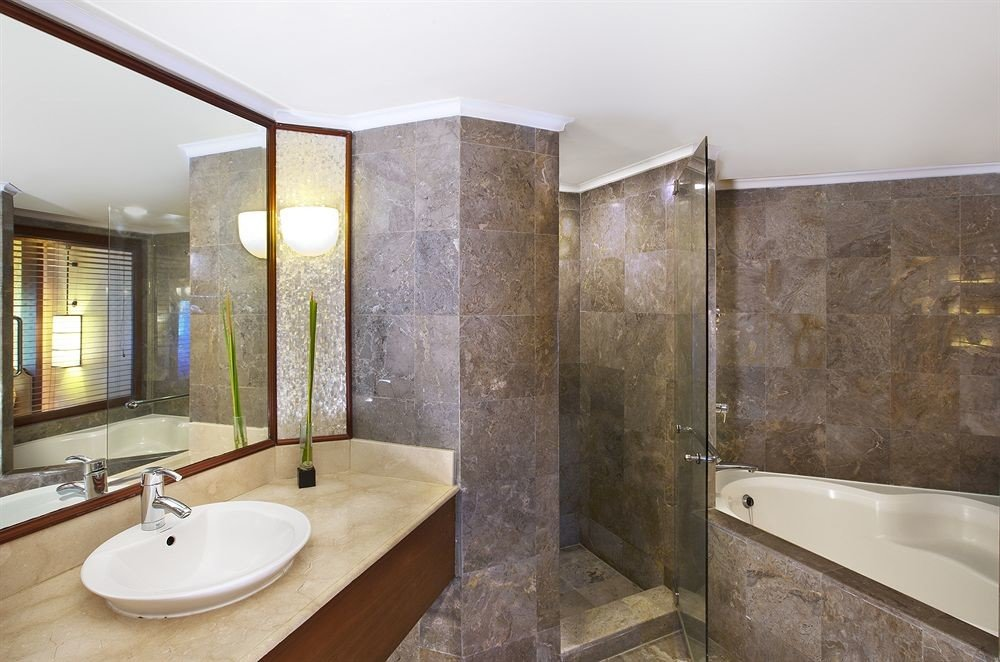 bathroom property sink bathtub shower home plumbing fixture Suite flooring toilet tan tub tile tiled Modern Bath